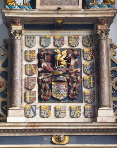 The several coats of arms at the top of the William Paston monument.